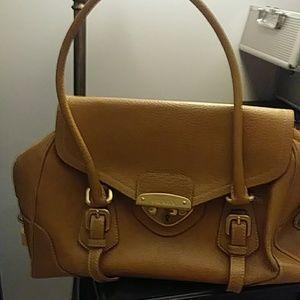 Tan Prada vintage medium purse in great condition.